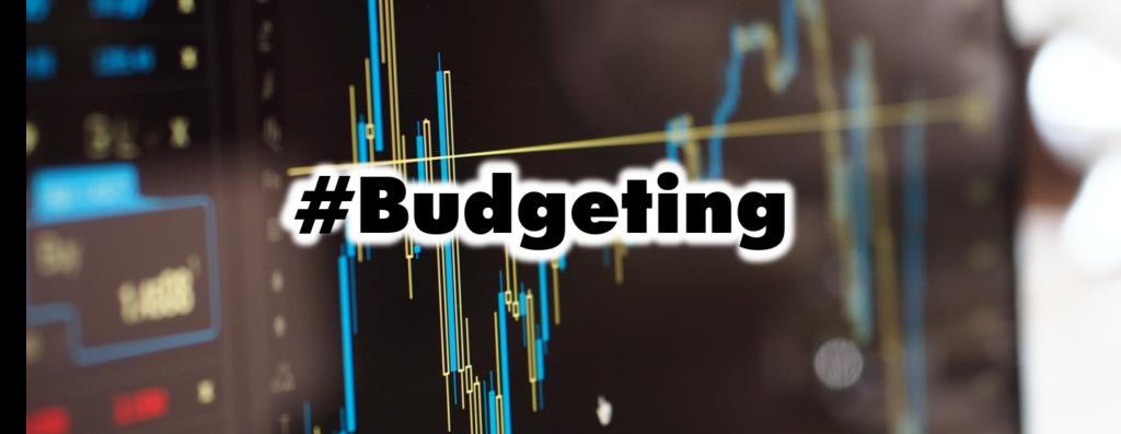 análisis de presupuestos grafica azul en fondo negro.